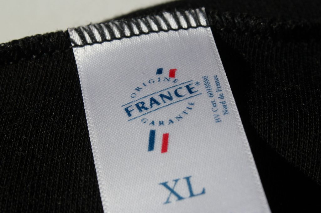 L'étiquette d'un sous-vêtement DXR Vaillant, ornée du logo Origine France Garantie
