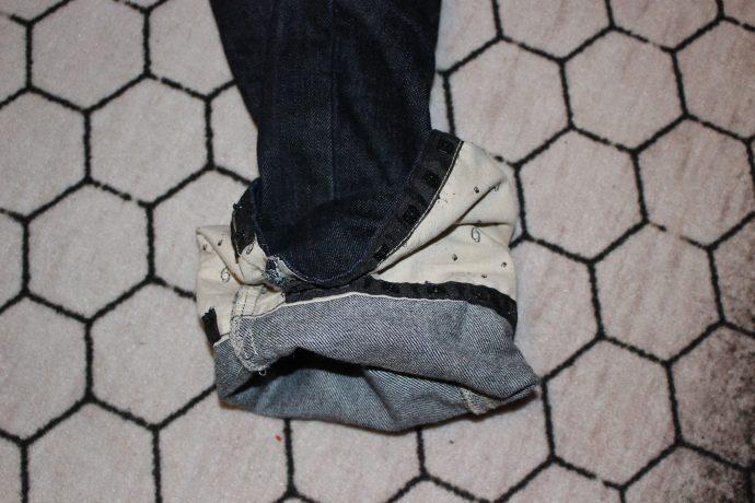 Ourlet à pression sur jean moto esquad