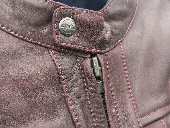 pression et zip du blouson DXR